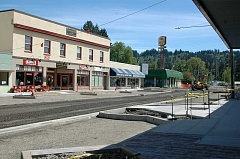 ESTACADA NEWS PHOTO: ISABEL GAUTSCHI - Check out those sidewalks! Work on the Broadway Streetscape Project continues in downtown Estacada. An open house on construction progress has been scheduled for 5:30-6:30 p.m. Thursday, April 30, at City Hall, 475 S.E. Main St. This view of Broadway Street in Estacada is from Monday, April 27. The project, funded by the Estacada Urban Renewal Agency, is upgrading the downtown street, sidewalks, curb, landscaping and more.