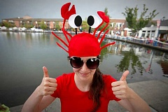 TIMES PHOTO: JONATHAN HOUSE - Erin Carmona gets into the spirit of the Tualatin Crawfish Festival in 2013. The America's Best Communities competition has named Tualatin one of America's best places to live.