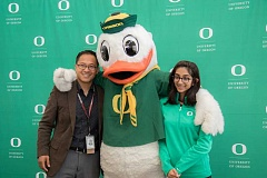 PHOTO CREDIT: BEAVERTON SCHOOL DISTRICT - The Oregon Duck mascot and Westview High School Principal Jon Franco help Apoorva Somayazulu celebrate her receipt of the Stamps Scholarship, one of the most prestigious and generous scholarships offered at the University of Oregon.