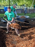 CONTRIBUTED PHOTO: AARON HOCKLEY - Comcast technician Lawrenc Escobedo spreads bark dust at Glenfair Elementary School on Comcast Cares Day.