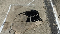 COURTESTY KOIN 6 NEWS - Crews responded to to repair a large hole in a westbound lane of I-84 near Troutdale.