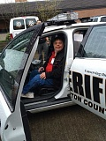 SUBMITTED - Andy Gardner, of Tigard, checks out the inside of a Washington County Sheriff's Office patrol car as part of the Westside Crime Prevention Coalition's safety academy, which wrapped up this week at Beaverton Police Department.