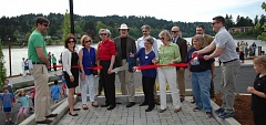 PHOTO BY: KATHY SCHAUB - Local leaders cut the ribbon to the mark the grand opening of Milwaukie Riverfront Park on Friday, May 1.