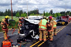 CLACKAMAS FIRE - Local firefighters using the 'Jaws of Life' to get someone out of a crashed vehicle.
