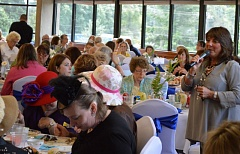 PHOTO BY: ROXANDRA PENNINGTON - Commissioner Martha Schrader hosts last year's CCHS tea overlooking Willamette Falls in the MOOT Tumwater Room off Highway 99E in Oregon City.