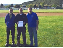 CONTRIBUTED PHOTO - Crook County High School Athletic Director Rob Bonner, left, Robberson Ford General Manager Joe MItchell, and Booster Club President Joe Becker announce that they have collaborated to bring a new scoreboard to the school's baseball field.