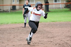 JOHN WILLIAM HOWARD - Scappoose's Nicole Lukinbeal lets out a yelp as she slips on mud between second and third base during the Indians' game on Tuesday against Valley Catholic. Lukinbeal came up with an in-the-park home run as Scappoose won 11-1.
