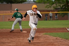 JOHN WILLIAM HOWARD - St. Helens junior Beau Mason dashes for third in the bottom of the seventh inning on Wednesday evening. Mason scored a few minutes later, part of a six-run rally as the Lions beat Putnam 7-6.
