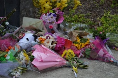 SPOTLIGHT PHOTO: COURTNEY VAUGHN - Flowers, toys and notes have been laid outside the entrance to Scappoose High School  as a makeshift memorial for Kerrigan Clark, a 17-year-old student who died last Wednesday, May 6, in a single-car crash off Northwest Cornelius Pass Road.