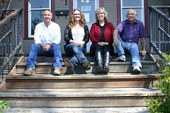 JASON CHANEY - The staff of Crook County Properties takes time out of the work day for a photo on the steps of their Northeast Third Street office. Pictured left to right are Mike Warren Jr., Tracy Martinez, Barbara Warren, and Mike Warren Sr.