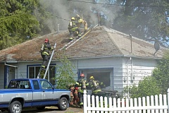 COURTESY PHOTO - Hillsboro firefighters vented the roof of a home on Northeast Cornell Boulevard last Friday to release the billowing smoke.