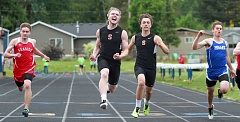 MILES VANCE, BEAVERTON VALLEY TIMES - Scappoose junior Braden Clark lets out a roar after winning the 100 meters at the Cowapa League Track and Field championships at Banks High School on Friday, May 15.