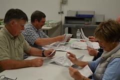 COURTNEY VAUGHN - Elections workers tally ballots in a room at the Columbia County Courthouse Wednesday, May 19, hours before the deadline to drop off ballots. Pictured left to right: Scott Bauska, Mike Simpson, Sharon Howell and Bob Clore.
