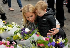 REVIEW PHOTO: VERN UYETAKE - Amy Pritchard and her nephew, Fritz, check out bouquets of flowers on opening day at the Lake Oswego Farmers Market.