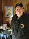 TRIBUNE PHOTO: DEAN BAKER - Walter Hull poses in front of a photo of his hero: Civil War Medal of Honor winner Joshua Chamberlain, professor and leader at Gettysburg, victor at Little Round Top.