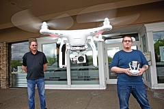 TIMES PHOTO: JAIME VALDEZ - Chris Griggs watches Drones Plus co-worker, Kenneth Silverton, fly a Phantom 3 drone at the business at Beaverton Town Square.