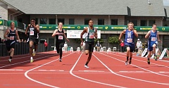 JIM BESEDA/MOLALLA PIONEER - Colton's Malik Knott (center, lane 4) won his heat of the boys' 100-meter dash in a time of 11.09 seconds Thursday in Eugene.