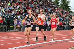 JIM BESEDA/MOLALLA PIONEER - Molalla's Amanda Clarizio runs on the heels of Sisters' Aria Blumm and slightly ahead of Seaside's Charlotte Blakesley with two laps remaining in Saturday's Class 4A girls' 1,500-meter run final at Hayward Field.