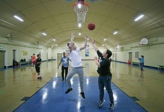 TRIBUNE PHOTO: JONATHAN HOUSE - Youths play basketball at Montavilla Community Center. The center would be converted to a teen center from 3 to 10 p.m., under Mayor Hales' proposal.