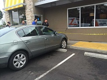 TUALATIN POLICE.  - Tualatin Police say a woman crashed into a McDonald's restaurant on Tuesday morning, injuring one person.