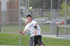 LON AUSTIN/CENTRAL OREGONIAN - Jack Stubblefield follows through after an overhead smash during the third and fourth-place match at the district tournament. Stubblefield won the first set, but eventually lost the match.