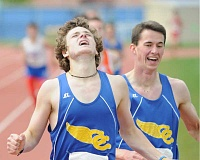 LON AUSTIN/CENTRAL OREGONIAN - Liam Pickhardt edges teammate Nathan Carmack for first place in the 1,500 meter run during Saturday's second day of the Tri-Valley League District Championships. The Cowboys ran away from the field, winning the district championship by more than 80 points.