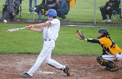 LON AUSTIN/CENTRAL OREGONIAN - Kohlter Kee raps a double into center field during the third inning of the Cowboys' 18-3 loss to the Philomath Warriors. Kee drove in a run with the hit, but the Cowboys season ended with the loss.