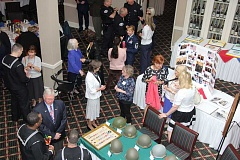 SUBMITTED PHOTO: RALPH WALKER - Displays at last weeks luncheon honoring U.S. military personnel included memorabilia and a cake for every branch of the Armed Forces. The event was held at Oswego Lake Country Club.