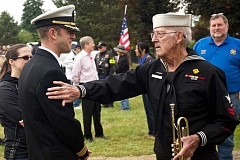 TIMES PHOTO: JAIME VALDEZ - Navy veteran George Hager, 90, wishes Commander Jonathan Puskas of Lake Oswego well after the two spoke after the Memorial Day ceremony at Winona Cemetery in Tualatin. Hager played the bugle during the ceremony, something he did when he was aboard the USS Fulton from 1942-1945.