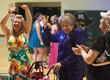 OUTLOOK PHOTO: JOSH KULLA  - Irene Hansen (in purple) didn't let her walker get in the way of a good time at the Senior Citizen Prom at Reynolds High School.