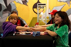 SUBMITTED - Carson St. Denis, right, shakes hands with an opponent during the 2013 National Championships. St. Denis is a phenom in the game of competitiion Pokemon battles. He has been to the World Championships in the Pokemon card game division, and is ranked in the top 25 in the country for the video game.