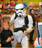 RITA A. LEONARD - Konner, age 7, meets a Star Wars Storm Trooper, while a parent captures the moment, and Oodles 4 Kids owner Carolyn Miye looks on in the background.