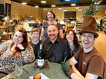 ELIZABETH USSHER GROFF - The winning team at this Woodstock evening of trivia was the UF Tree Nuts - former and current staff of Portland Urban Forestry. Seated, from left: Natasha Lipai, Elizabeth Specht, Jim Gersbach, and Emily Wilson. And, standing, Ruth Williams; and at far right, Taylor Meek, wearing a tree hat created by Williams.