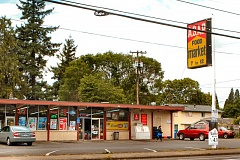 DAVID F. ASHTON - After police took the armed robbery report from an employee of this neighborhood market, they left the area, looking in vain for the suspects getaway car.