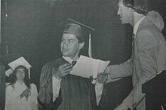 ARCHIVE PHOTO: JAMES H. LIENHARD - The caption to this 1985 photo read:' Estacada School Board-picked Citizen of the Year Dominic Franco receives his award from Estacada High School Principal Mike Wittmayer and applause from fellow graduates during May 30 commencement ceremony. Franco became Estacada's first severely mentally handicapped graduate.'