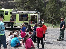 CONTRIBUTED PHOTO - Members of the BLM wildland firefighting crew explain to fourth-graders what they do and show them the equipment they use to extinguish fires on BLM land.