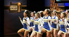 SETH GORDON - Reaping the rewards - The Newberg cheerleaders perform at Nike World Headquarters as the opening act for the Oregon Sports Awards June 11 in Beaverton. The Tigers were invited after winning state and national championships in 2015.
