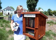 (Image is Clickable Link) SPOKESMAN PHOTO: EMERSON  MALONE - Wilsonville resident Kelly Bartlett built the city's first Little Free Library next to her neighborhood playground.