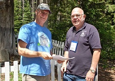 CONTRIBUTED PHOTO - Mike Norris, left, Clackamas County Historical Society president, and Lloyd Musser, Mt. Hood Cultural Museum curator, meet at Summit Meadows cemetery.