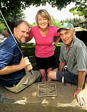 REVIEW PHOTO: VERN UYETAKE - The Dedication Stone was established at the first Oliphant Community Golf Tournament in 2014. Helping to carry on the tradition are Tom Mueller (from left), Beth Oliphant Hoover and Michael Harper.