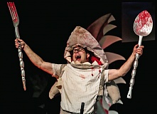 PHOTOS COURTESY: JASON WELLS - Yummy! The dreaded killer shark uses a big fork and spoon in J.A.W.Z. The Musical - in 3D!