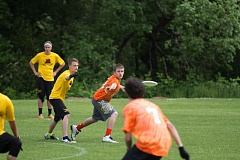 SUBMITTED PHOTO - Gladstone High School Junior Brookes Schassen throws the Frisbee to senior Brian Kinnes.
