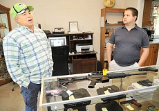 GARY ALLEN - Gun store - Rick (left) and Nick Swecker are the proprietors of a new firearms business in Newberg called One Shot Gun Shop. One of their goals is to educate new and unfamiliar clients about firearms.