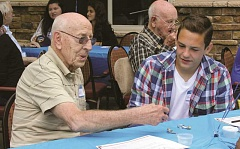 INDEPENDENT PHOTO: TYLER FRANCKE - Cascade Park Retirement Community resident Wally Dale talks with Karson Christiansen, a member of the Woodburn Youth Advisory Board.
