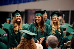 CONNECTION PHOTO: KELSEY O'HALLORAN - Exchange student Shari Uhlig smiles for the crowd as she and other exchange students are recognized during the commencement ceremony.
