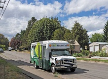 NEWS-TIMES FILE PHOTO - A GroveLink bus waits on a city street for Forest Grove passengers to board.