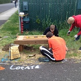 PHOTO COURTESY TY LUKINBEAL  - Ty Lukinbeal (front) works with friends to assemble a wooden bench that was later placed along the Crown Zellerbach Trail in Scappoose. Lukinbeal installed four benches along the trail.