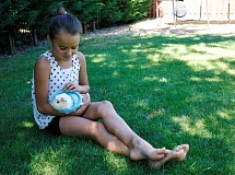 POST PHOTO: KYLIE WRAY - Lilly Potter spends time in her backyard with Cupcake the guinea pig. The animal enthusiast loves spending time with her family and caring for her pets.