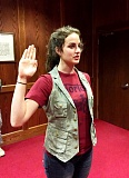 PHOTO BY: NICK CHOY - Mackenzie Clarke of Damascus takes the oath of enlistment into the Oregon Army National Guard.