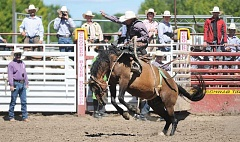 CENTRAL OREGONIAN FILE PHOTO - Rusty Wright competes in saddle bronc riding at last year's Roundup. Wright is one of many cowboys expected to return this year.